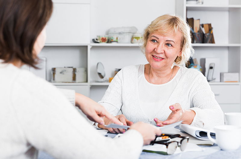 elderly woman meeting with other woman