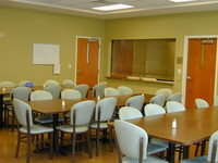 image of Alternatives' dinning room three tables with chairs