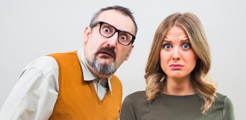 Man and woman looking anxious