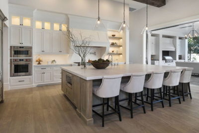white huge kitchen island with white chairs
