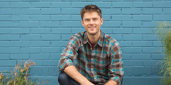 Charlie sitting near blue wall