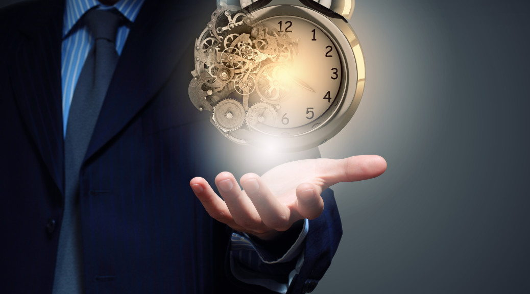 Close up of businessman hand holding old alarm clock
