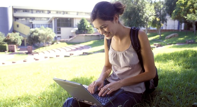 College girl on laptop at school