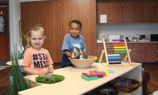 Preschoolers learn while playing at the Mitchell Early Childhood and Family Center.