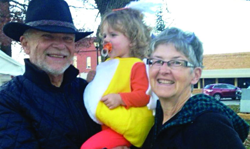 Founding Board Member Bud Herron with wife Ann and granddaughter Zoë