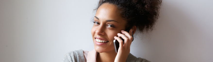 Smiling woman making a phone call