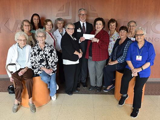 DeKalb Memorial Hospital Fundraising Guild presents check to Dekalb Health leadership