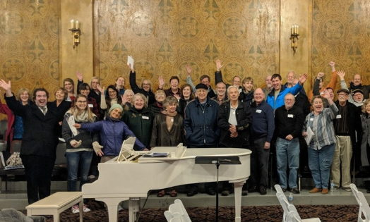 Participants of Masterworks Chorale's 2018 Music That Makes Community Workshop celebrate together after a day of learning chorale techniques.