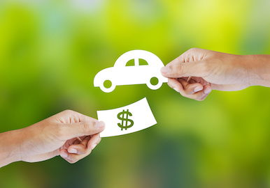 Image of two hands exchanging a car for money