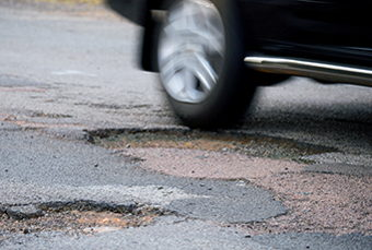 Image for Auto Insurance and . . . Pothole Damage?