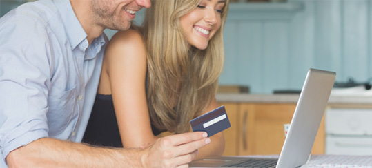 Man and Woman using a debit card online