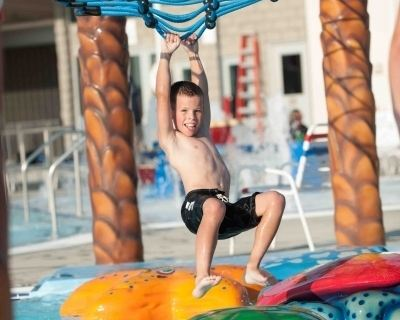 boy playing at water park freedom springs