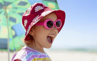 Cheerful girl on sunny beach