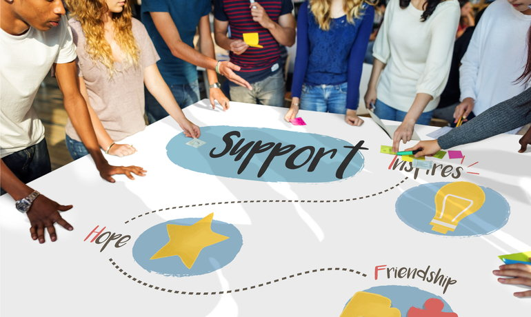 Group of students around a table planning fundraiser