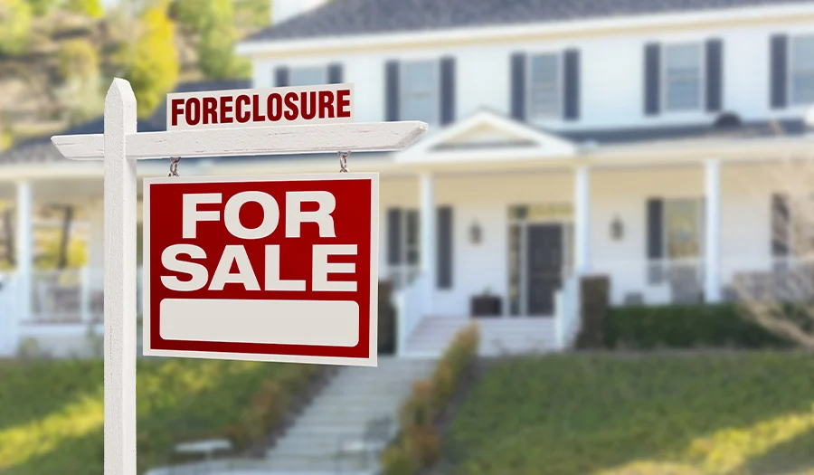 House foreclosure sign infront of house
