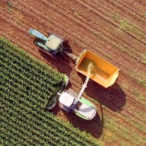 aerial view of a tractor harvesting a fiel