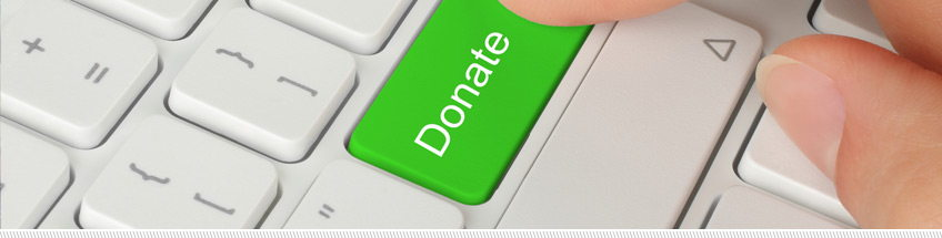 green donate button superimposed on traditional computer keyboard