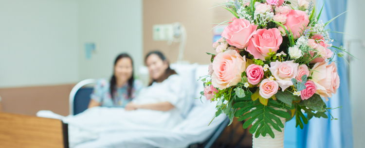 Bouquet of flowers with patients in the background