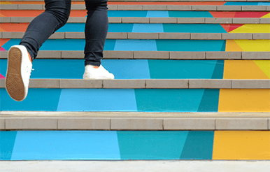 Walking up colorful steps.