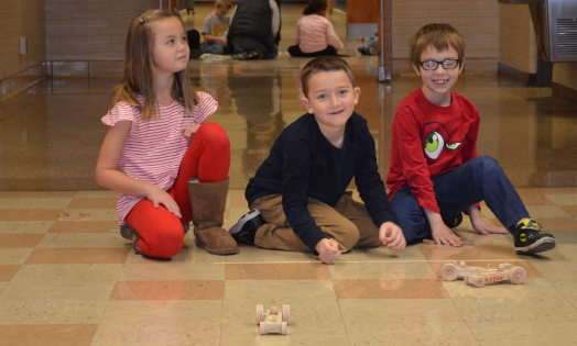 Cowan elementary students learn about force and drag with rubber band racers.