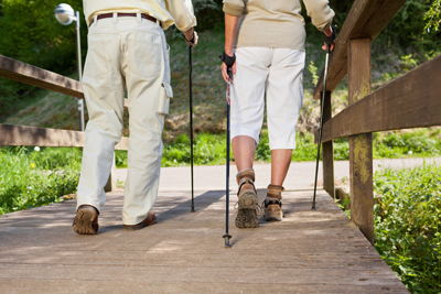 Focus on older man and woman's legs while hiking