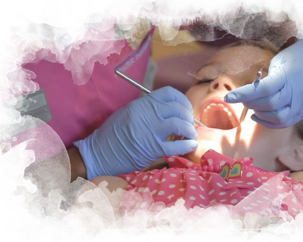 Image of a child getting their teeth cleaned