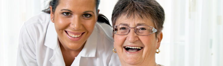 Smiling medical professional with smiling patient