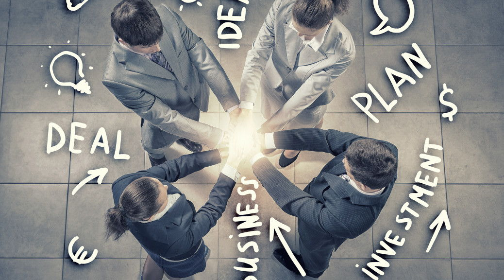 Top view of business people with hands in stack