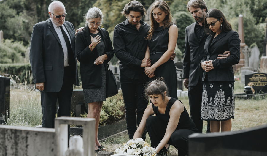 family grieving at funeral