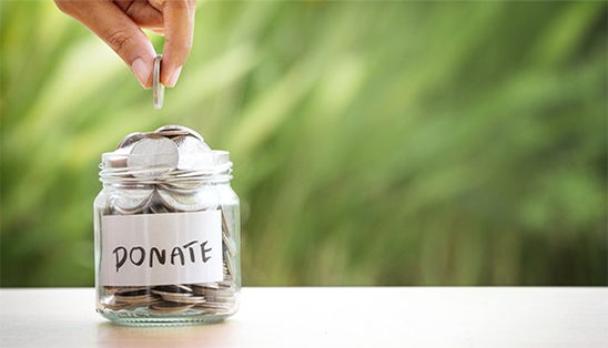 Depositing Money in a Donation Jar
