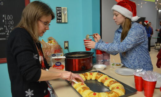 Students at Heritage Hall celebrate Latin American Christmas with traditional treats.