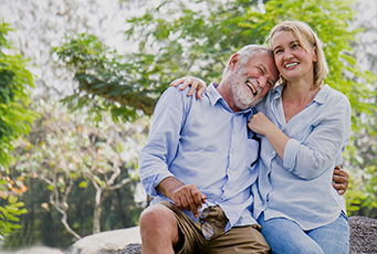 Happy Retired Couple outside. Social Security Benefits for Your Spouse
