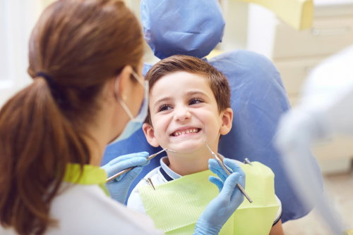 Image of a boy smiling at the dentist