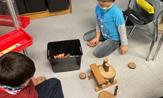 Students in Nancy Shreve's kindergarten classroom at Selma Elementary School worked together to plan and implement projects with a variety of building materials including tree blocks (pictured).