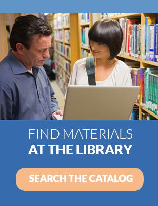 Older white man with dark hair standing next to a young white woman with short dark hair holding a laptop in front of bookshelves. Text says Find Materials at the library Search the Catalog