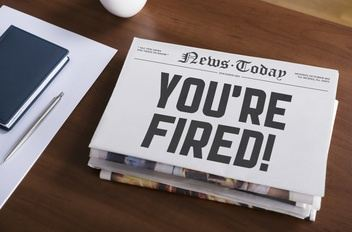 newspaper with you are fired headline