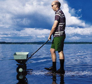 Image of man using fertilizer in water