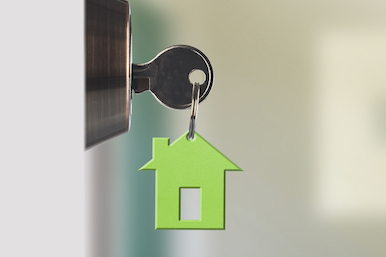 Image of house key in lock