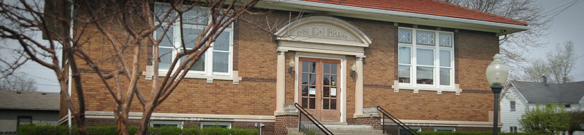 brick Carnegie library facade with tile roof