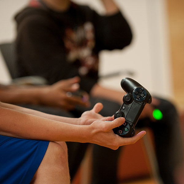 Image of person holding a video game controller