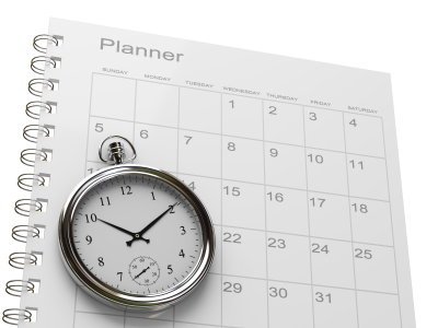Image of a clock and calendar with the title Planner