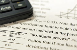 Image of calculator on document talking about Six Sigma