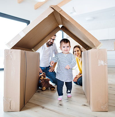Family Playing with Boxes Shaped Like House