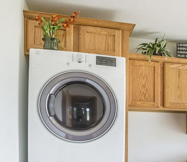 ENCLOSED STACKED WASHER AND DRYER
