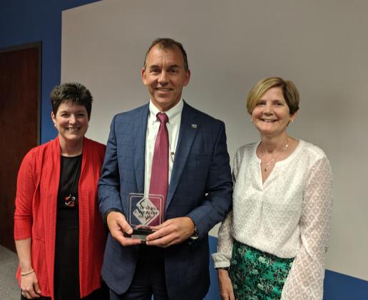 Kelly K. Shrock and Carol Seals pose with 2019 David Sursa Leadership Award Recipient, Chris Caldwell.