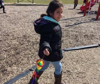 Kindergarten student uses a wind sock