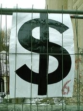 dollar sign behind thin metal bars