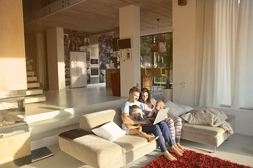 parents and kids sitting on couch in living room