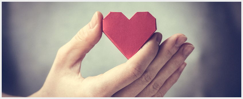 hand holding paper heart