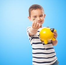 boy with coin infront of blue background